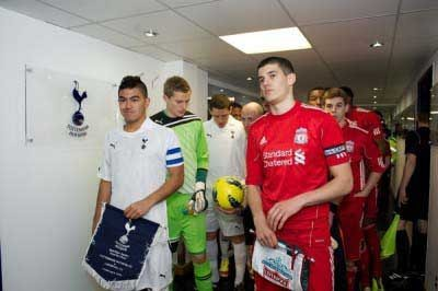 Conor Coady leads Jon Flanagan and the rest of his NextGen team mates out last season against Spurs (Pic: David Rawcliffe)