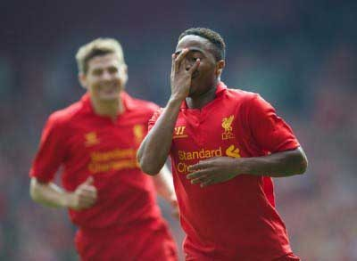 Academy past and present: Steven Gerrard looks on as Raheem Sterling celebrates (Pic: David Rawcliffe)