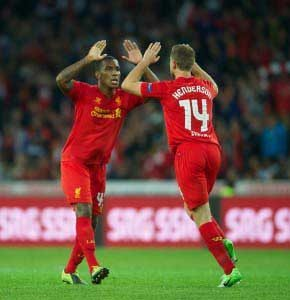 Andre Wisdom congratulated by Jordan Henderson after scoring on his first team debut against Young Boys (Pic: David Rawcliffe)