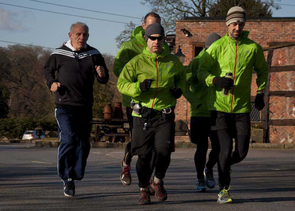 Peter Reid, sets off with runners part of their 96 mile run between Hillsborough and Anfield