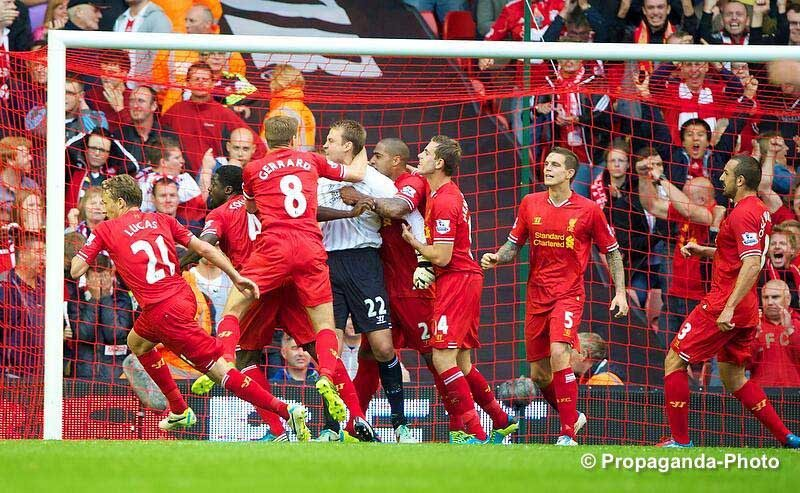 Mignolet mobbed after the penalty save (Pic: David Rawclifee / Propaganda)