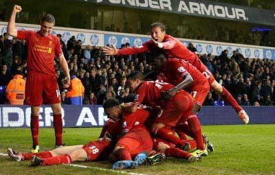 SUPER FLAN: Jon Flanagan is mobbed after his superb first goal for Liverpool