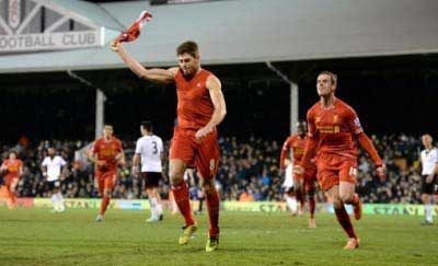 STEVEN GERRARD TAKING HIS TOP OFF AFTER ONE OF HIS GOALS. Pic: David Rawcliffe-Propaganda.