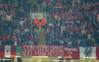 Liverpool fans with banner reading 'Don't Bomb Iraq, Nuke Manchester' during the Football League Cup Final against Manchester United at the Millennium Stadium