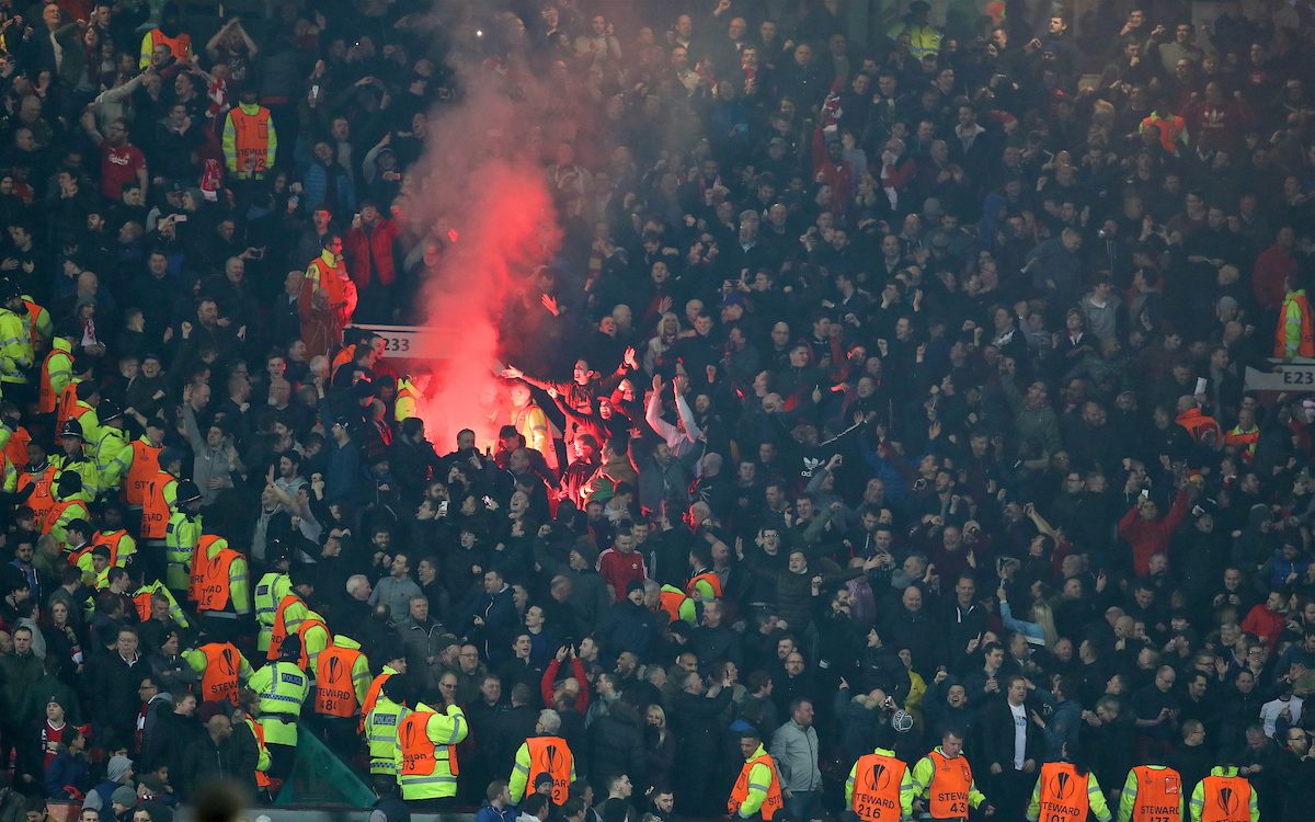 MANCHESTER, ENGLAND - Wednesday, March 16, 2016: Liverpool supporters celebrate their first equalising goal against Manchester United by setting off a smoke bomb during the UEFA Europa League Round of 16 2nd Leg match at Old Trafford. (Pic by David Rawcliffe/Propaganda)