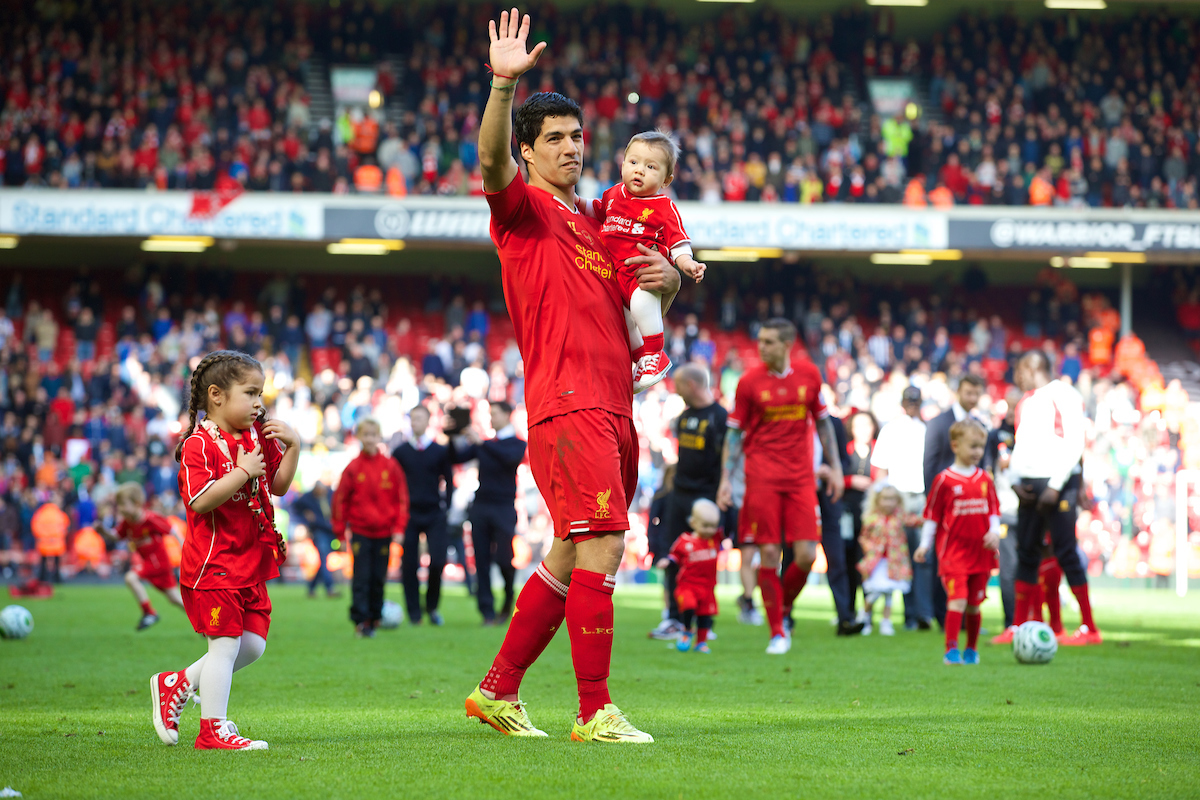 LIVERPOOL, ENGLAND - Sunday, May 11, 2014: Liverpool's Luis Suarez with his daughter Delfina and son Benjamin after the Premiership match against Newcastle United at Anfield. (Pic by David Rawcliffe/Propaganda)