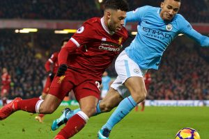 LIVERPOOL, ENGLAND - Sunday, January 14, 2018: Liverpool's Alex Oxlade-Chamberlain and Manchester City's Danilo Luiz da Silva during the FA Premier League match between Liverpool and Manchester City at Anfield. (Pic by David Rawcliffe/Propaganda)