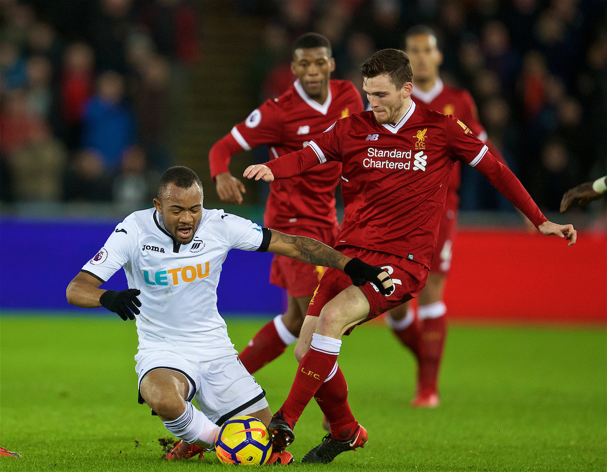 SWANSEA, WALES - Monday, January 22, 2018: Liverpool's Andy Robertson and Swansea City's Jordan Ayew during the FA Premier League match between Swansea City FC and Liverpool FC at the Liberty Stadium. (Pic by David Rawcliffe/Propaganda)