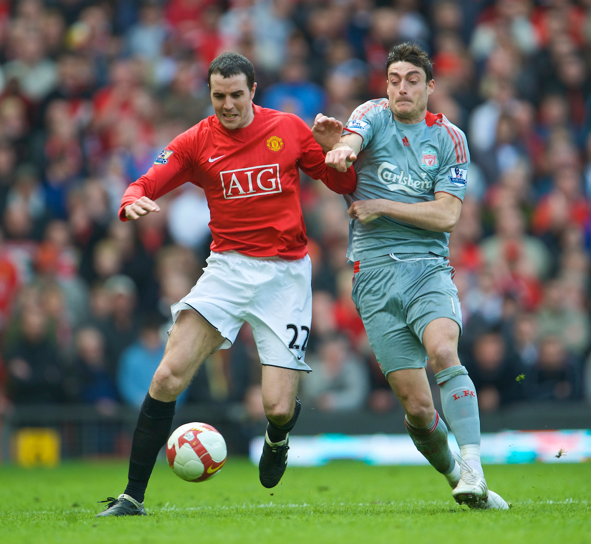 MANCHESTER, ENGLAND - Saturday, March 14, 2009: Liverpool's Albert Riera and Manchester United's John O'Shea during the Premiership match at Old Trafford. (Photo by David Rawcliffe/Propaganda)