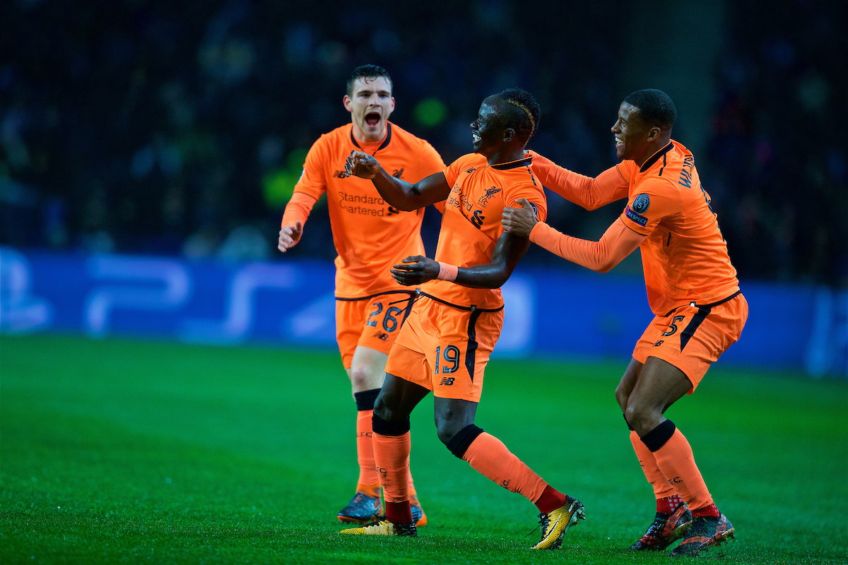 PORTO, PORTUGAL - Wednesday, February 14, 2018: Liverpool's Sadio Mane celebrates scoring the first goal with team-mates Andy Robertson and Georginio Wijnaldum during the UEFA Champions League Round of 16 1st leg match between FC Porto and Liverpool FC on Valentine's Day at the Estádio do Dragão. (Pic by David Rawcliffe/Propaganda)