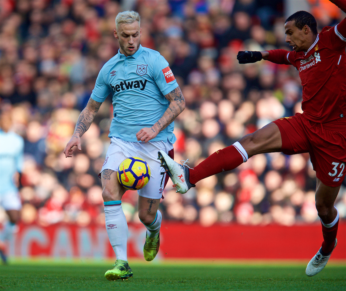 LIVERPOOL, ENGLAND - Saturday, February 24, 2018: West Ham United's Marko Arnautovic and Liverpool's Joel Matip during the FA Premier League match between Liverpool FC and West Ham United FC at Anfield. (Pic by David Rawcliffe/Propaganda)