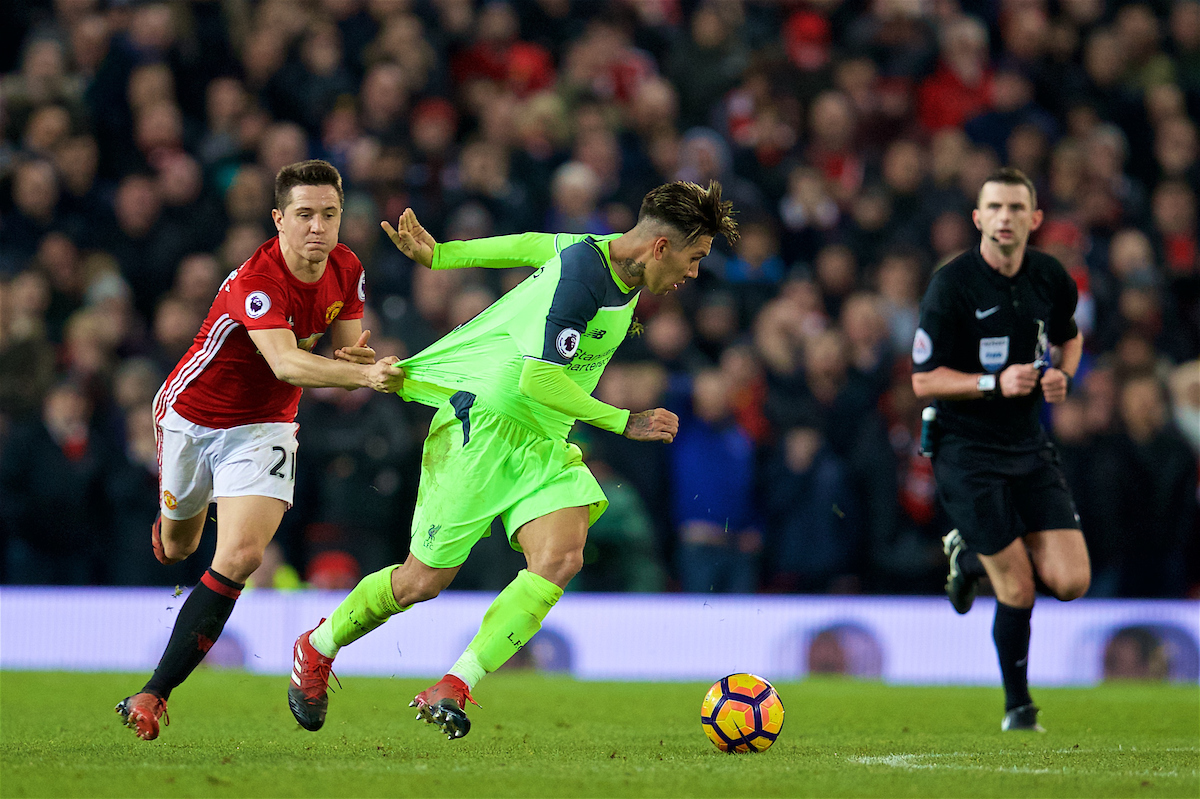 MANCHESTER, ENGLAND - Sunday, January 15, 2017: Liverpool's Roberto Firmino is held back by Manchester United's Ander Herrera as he pulls his shirt during the FA Premier League match at Old Trafford. (Pic by David Rawcliffe/Propaganda)g