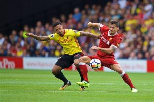 WATFORD, ENGLAND - Saturday, August 12, 2017: Liverpool's Dejan Lovren and Watford's Andre Grayduring the FA Premier League match between Watford and Liverpool at Vicarage Road. (Pic by David Rawcliffe/Propaganda)