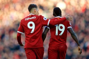 LIVERPOOL, ENGLAND - Saturday, February 24, 2018: Liverpool's Sadio Mane celebrates scoring the fourth goal with team-mate Roberto Firmino during the FA Premier League match between Liverpool FC and West Ham United FC at Anfield. (Pic by David Rawcliffe/Propaganda)