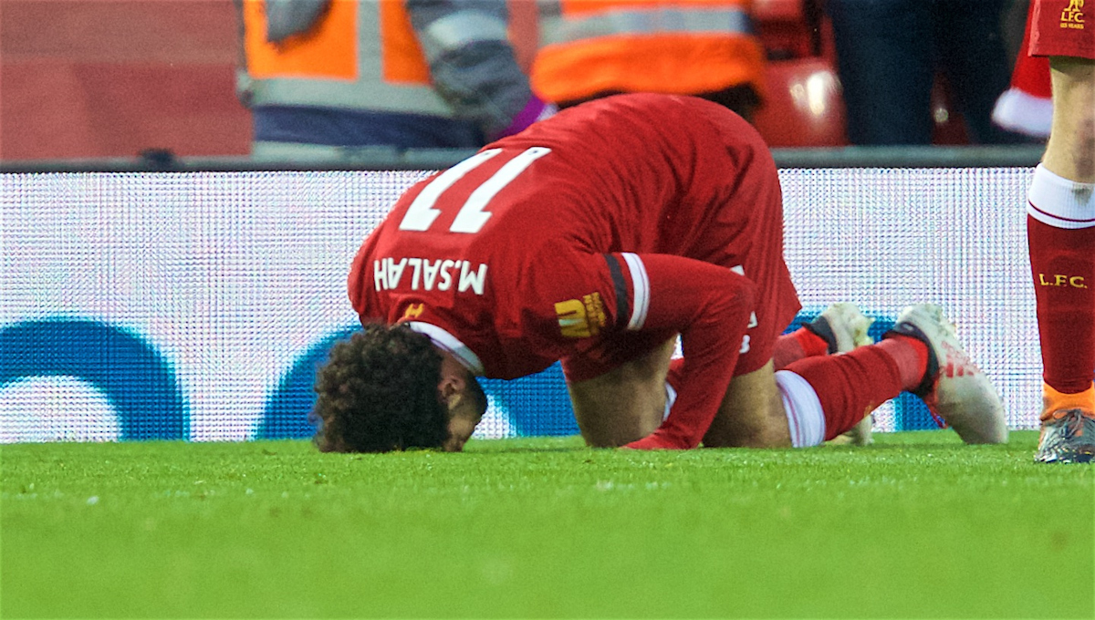 LIVERPOOL, ENGLAND - Saturday, March 17, 2018: Liverpool's Mohamed Salah kneels to pray as he celebrates scoring the second goal during the FA Premier League match between Liverpool FC and Watford FC at Anfield. (Pic by David Rawcliffe/Propaganda)