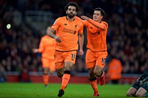 LONDON, ENGLAND - Friday, December 22, 2017: Liverpool's Mohamed Salah celebrates scoring the second goal with team-mate Philippe Coutinho Correia during the FA Premier League match between Arsenal and Liverpool at the Emirates Stadium. (Pic by David Rawcliffe/Propaganda)
