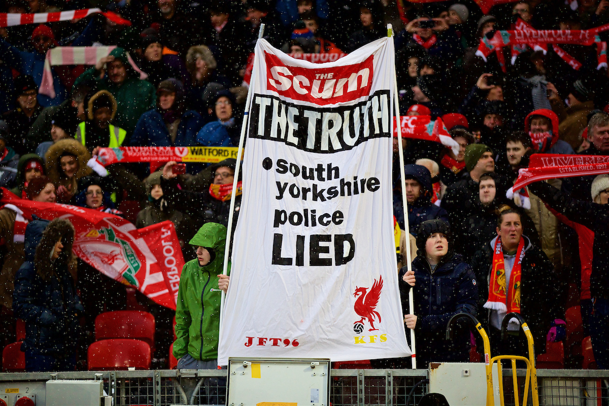 """LIVERPOOL, ENGLAND - Saturday, March 17, 2018: Liverpool supporters' banner 'The Scum [The Sun newspaper] The Truth South Yorkshire Police Lied"""" during the FA Premier League match between Liverpool FC and Watford FC at Anfield. (Pic by David Rawcliffe/Propaganda)"""