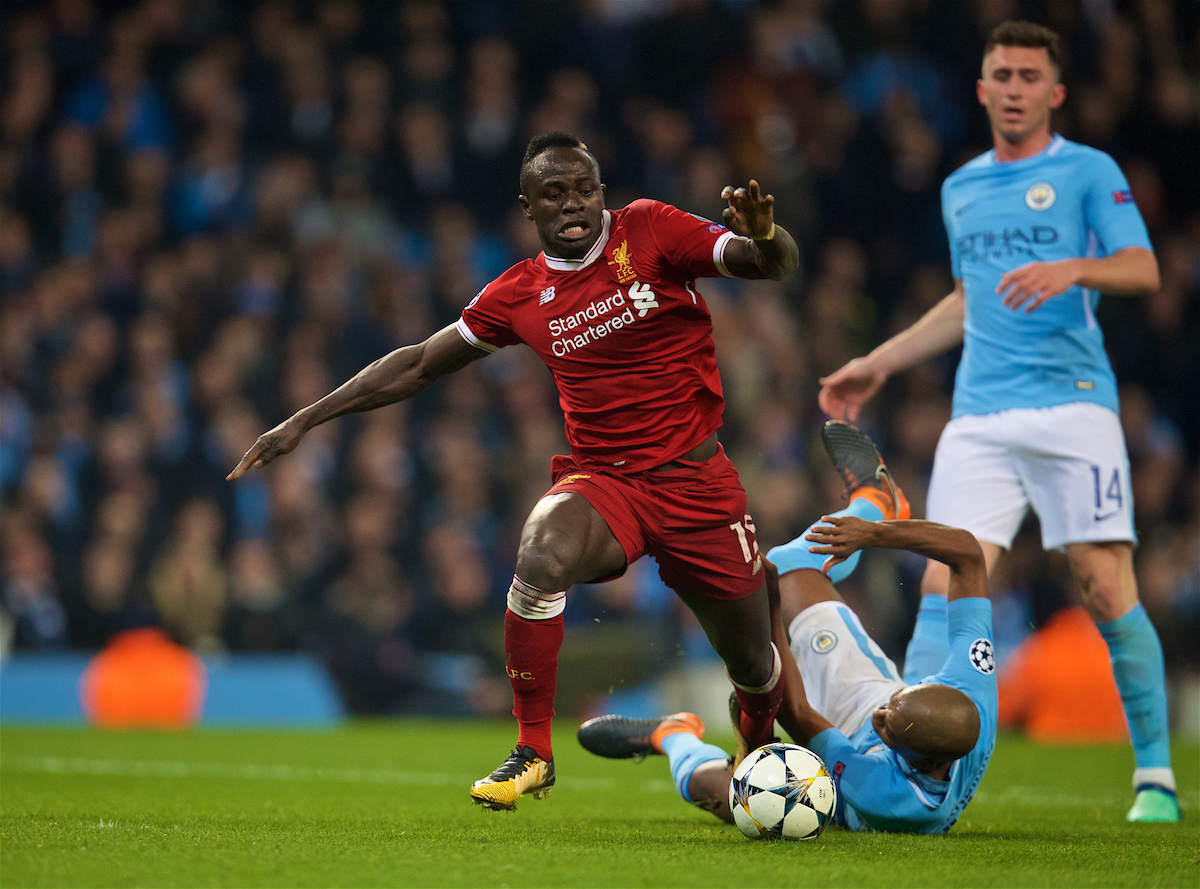 MANCHESTER, ENGLAND - Tuesday, April 10, 2018: Liverpool's Sadio Mane (left) is brought down by Manchester City's Fernando Luiz Roza 'Fernandinho' but the referee allows play-on for the Reds to score a vital away equalising goal and level the score at 1-1 during the UEFA Champions League Quarter-Final 2nd Leg match between Manchester City FC and Liverpool FC at the City of Manchester Stadium. (Pic by David Rawcliffe/Propaganda)