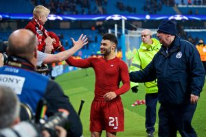 MANCHESTER, ENGLAND - Tuesday, April 10, 2018: Liverpool's Alex Oxlade-Chamberlain hands his shirt to a young supporter after the 2-1 (5-1 aggregate) victory over Manchester City during the UEFA Champions League Quarter-Final 2nd Leg match between Manchester City FC and Liverpool FC at the City of Manchester Stadium. (Pic by David Rawcliffe/Propaganda)