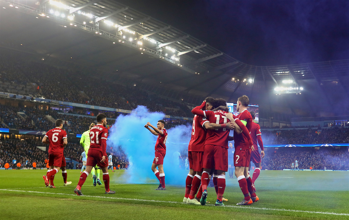 MANCHESTER, ENGLAND - Tuesday, April 10, 2018: Liverpool's Mohamed Salah celebrates scoring the first goal with team-mates as a blue smoke bomb billows in the pitch during the UEFA Champions League Quarter-Final 2nd Leg match between Manchester City FC and Liverpool FC at the City of Manchester Stadium. (Pic by David Rawcliffe/Propaganda)