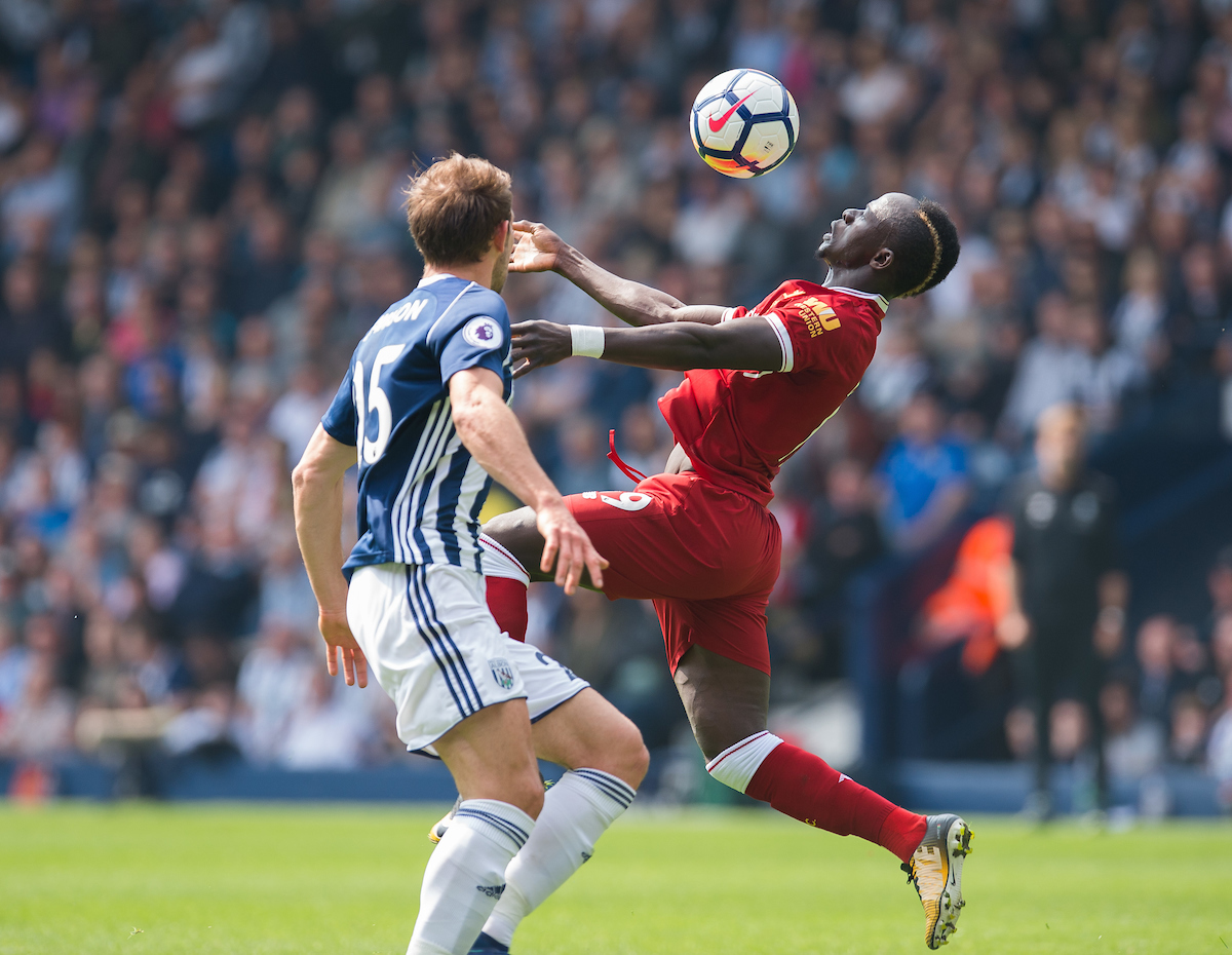 WEST BROMWICH, ENGLAND - Saturday, April 21, 2018: Liverpool's Sadio Mane in action with West Bromwich Albion's Craig Dawson during the FA Premier League match between West Bromwich Albion FC and Liverpool FC at the Hawthorns. (Pic by Peter Powell/Propaganda)