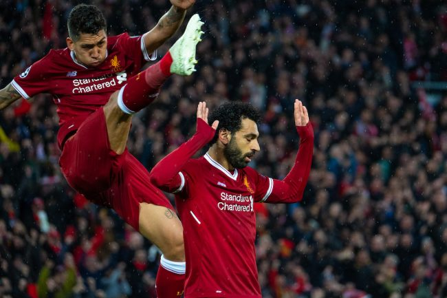 LIVERPOOL, ENGLAND - Tuesday, April 24, 2018: Liverpool's Mohamed Salah (right) celebrates scoring the second goal with team-mate Roberto Firmino during the UEFA Champions League Semi-Final 1st Leg match between Liverpool FC and AS Roma at Anfield. (Pic by Carlo Baroncini/Propaganda)