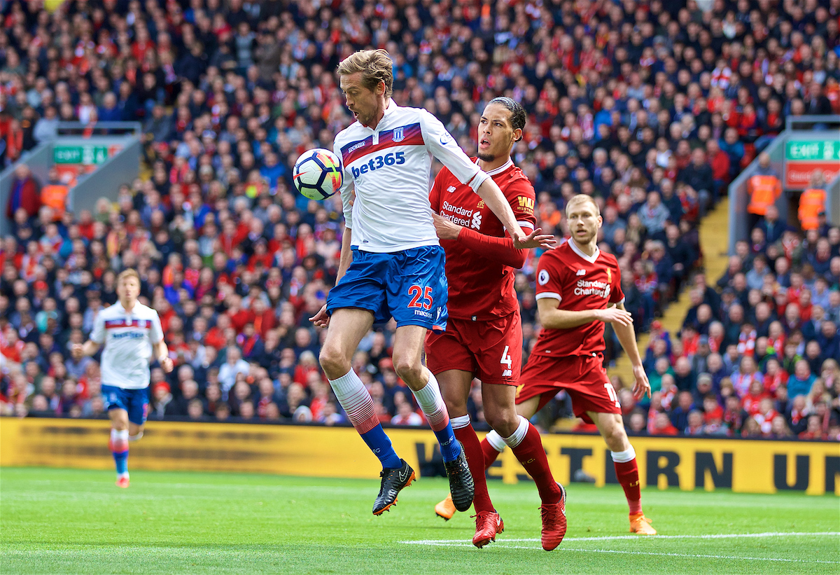 LIVERPOOL, ENGLAND - Saturday, April 28, 2018: Liverpool's Virgil van Dijk and Stoke City's Peter Crouch during the FA Premier League match between Liverpool FC and Stoke City FC at Anfield. (Pic by David Rawcliffe/Propaganda)