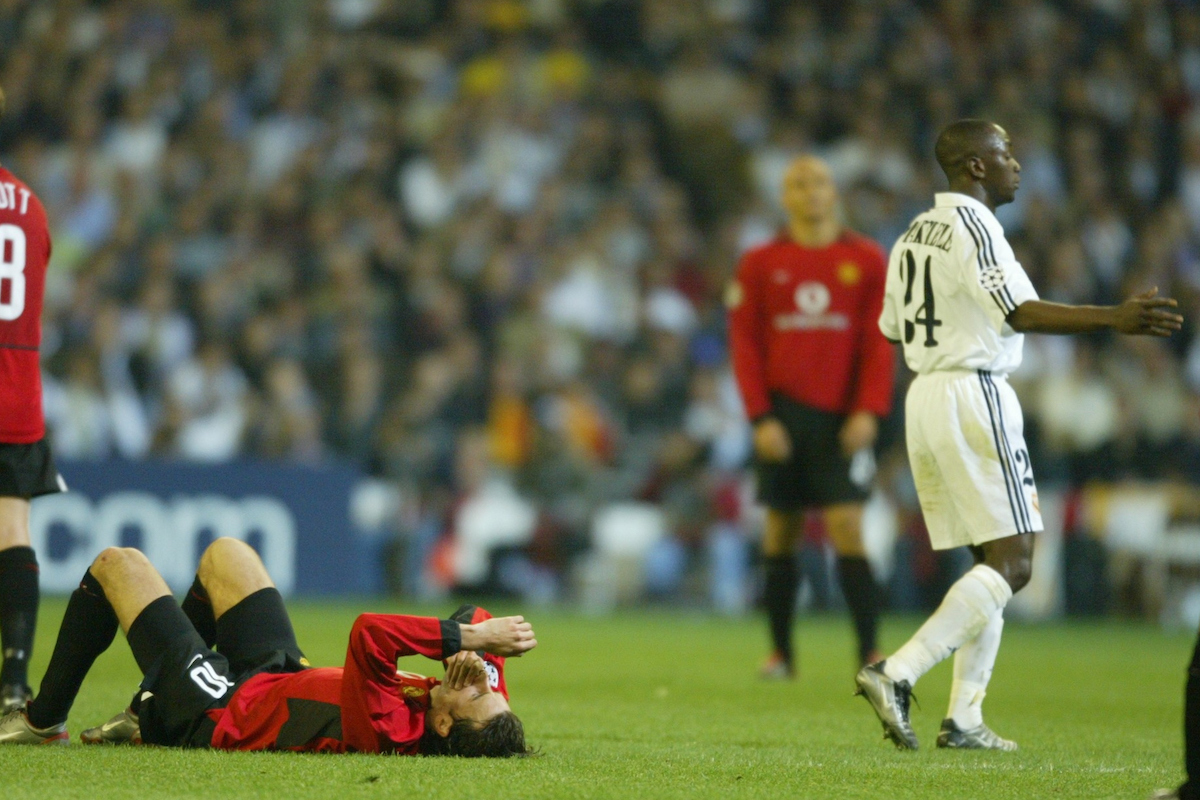 MADRID, SPAIN - Tuesday, April 8, 2003: Manchester United's Ruud Van Nistelrooy lies on the floor after pretending to be elbowed by Real Madrid's Claude Makelele during the UEFA Champions League Quarter Final 1st Leg match at the Estadio Santiago Bernabeu. (Pic by David Rawcliffe/Propaganda)