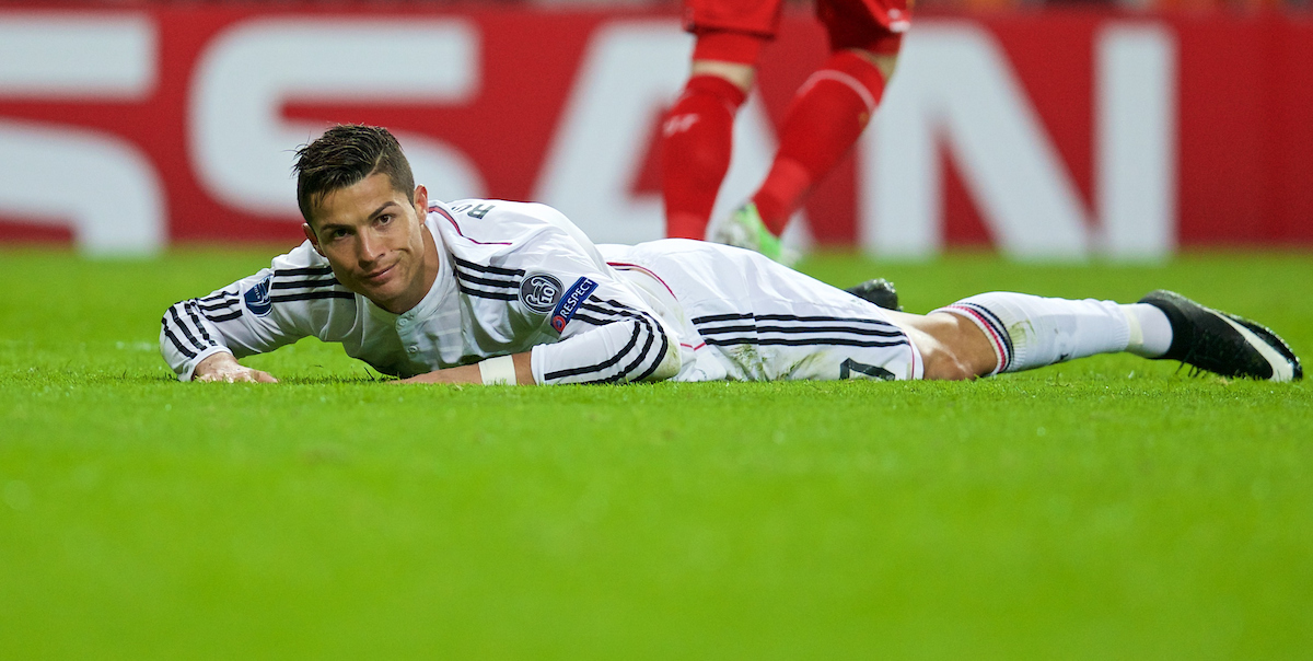 MADRID, SPAIN - Tuesday, November 4, 2014: Real Madrid's Cristiano Ronaldo looks dejected after being bundled off the ball during the UEFA Champions League Group B match against Liverpool at the Estadio Santiago Bernabeu. (Pic by David Rawcliffe/Propaganda)