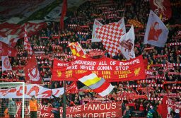 """LIVERPOOL, ENGLAND - Tuesday, April 24, 2018: Liverpool supporters on the Spion Kop hold up their scarves as they sing """"You'll Never Walk Alone"""" before the UEFA Champions League Semi-Final 1st Leg match between Liverpool FC and AS Roma at Anfield. (Pic by David Rawcliffe/Propaganda)"""