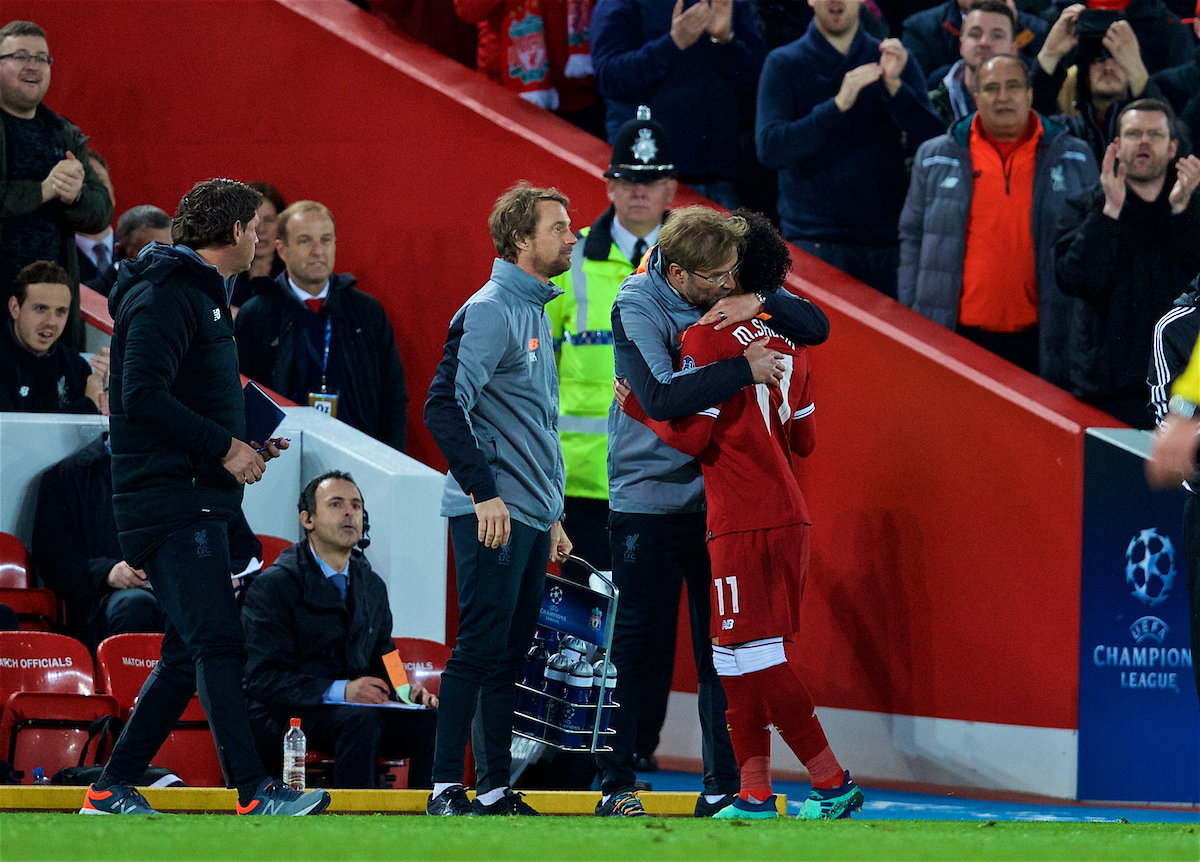LIVERPOOL, ENGLAND - Tuesday, April 24, 2018: Liverpool's Mohamed Salah is embraced by manager Jürgen Klopp as he is substituted during the UEFA Champions League Semi-Final 1st Leg match between Liverpool FC and AS Roma at Anfield. (Pic by David Rawcliffe/Propaganda)