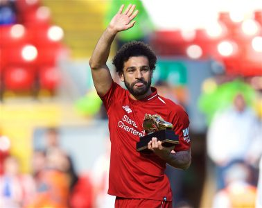 Liverpool's Mohamed Salah with the Premier League Golden Boot trophy for finishing the season as the leading League goal-scorer with 32 goals