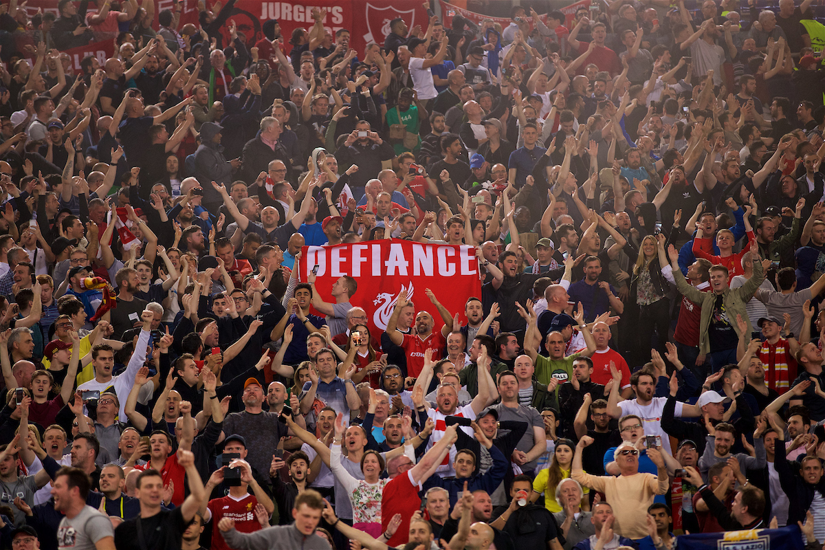 """ROME, ITALY - Wednesday, May 2, 2018: Liverpool supporters, with a banner """"Defiance"""", as they celebrate after the 7-6 aggregate victory over AS Roma during the UEFA Champions League Semi-Final 2nd Leg match between AS Roma and Liverpool FC at the Stadio Olimpico. (Pic by David Rawcliffe/Propaganda)"""