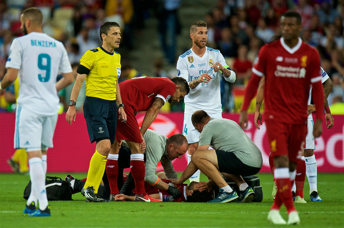 KIEV, UKRAINE - Saturday, May 26, 2018: Liverpool's Mohamed Salah is treated for an injury after being assaulted by Real Madrid's Sergio Ramos during the UEFA Champions League Final match between Real Madrid CF and Liverpool FC at the NSC Olimpiyskiy. (Pic by Peter Powell/Propaganda)