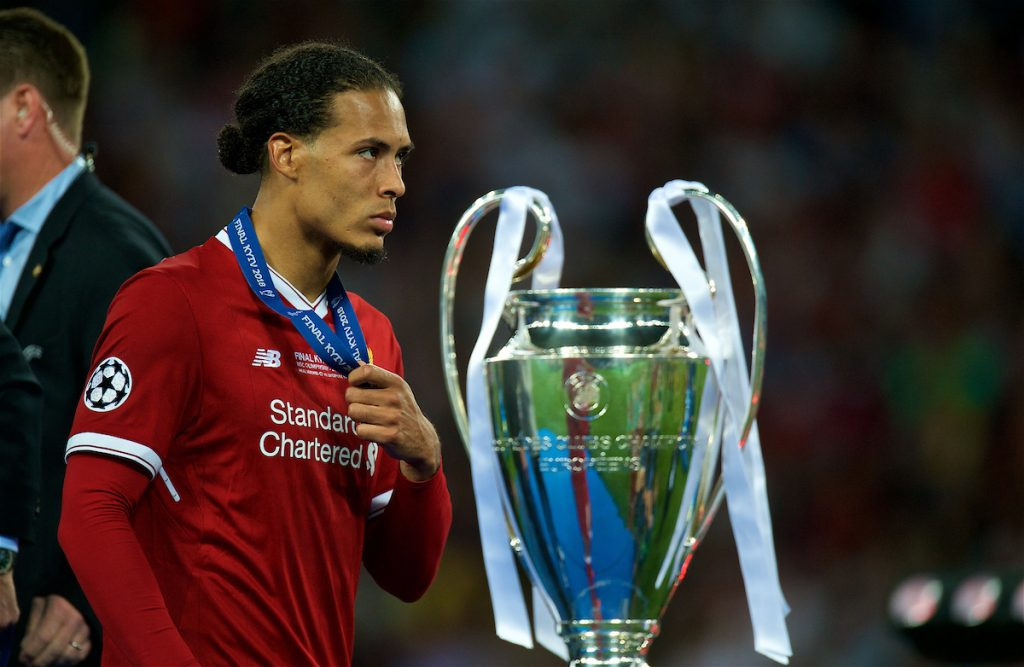 KIEV, UKRAINE - Saturday, May 26, 2018: Liverpool's Virgil van Dijk walks past the trophy dejected with his runners-up medal during the UEFA Champions League Final match between Real Madrid CF and Liverpool FC at the NSC Olimpiyskiy. Real Madrid won 3-1. (Pic by Peter Powell/Propaganda)