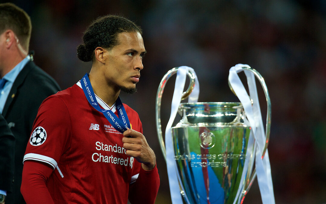 Liverpool's Virgil van Dijk walks past the trophy dejected with his runners-up medal during the UEFA Champions League Final match between Real Madrid CF and Liverpool FC at the NSC Olimpiyskiy