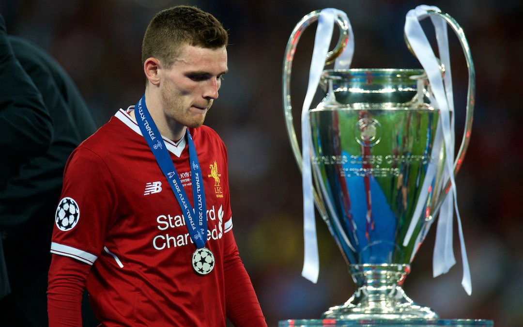 Liverpool's Andy Robertson walks past the trophy with his runner's-up medal after the UEFA Champions League Final match between Real Madrid CF and Liverpool FC at the NSC Olimpiyskiy. Real Madrid won 3-1.