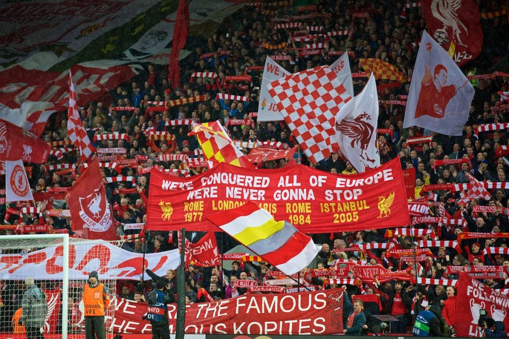 "LIVERPOOL, ENGLAND - Tuesday, April 24, 2018: Liverpool supporters on the Spion Kop hold up their scarves as they sing ""You'll Never Walk Alone"" before the UEFA Champions League Semi-Final 1st Leg match between Liverpool FC and AS Roma at Anfield. (Pic by David Rawcliffe/Propaganda)"
