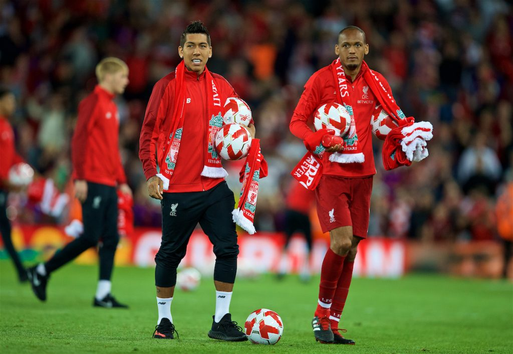 LIVERPOOL, ENGLAND - Tuesday, August 7, 2018: Liverpool's Roberto Firmino and Fabio Henrique Tavares 'Fabinho' hand out balls and scarves top supporters after the preseason friendly match between Liverpool FC and Torino FC at Anfield. (Pic by David Rawcliffe/Propaganda)