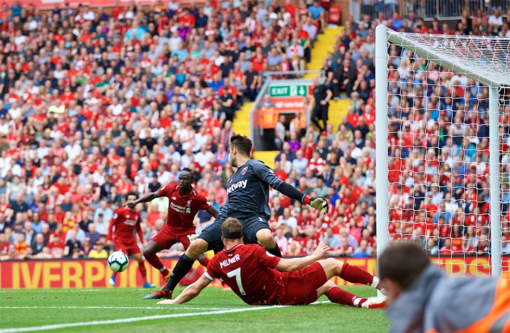 LIVERPOOL, ENGLAND - Sunday, August 12, 2018: Liverpool's James Milner crosses the ball for team-mate Sadio Mane to score the second goal during the FA Premier League match between Liverpool FC and West Ham United FC at Anfield. (Pic by David Rawcliffe/Propaganda)