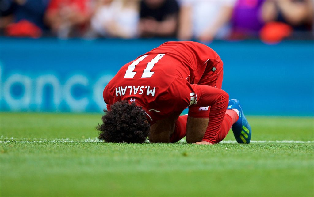 LIVERPOOL, ENGLAND - Sunday, August 12, 2018: Liverpool's Mohamed Salah,kneels to pray as he celebrates scoring the first goal during the FA Premier League match between Liverpool FC and West Ham United FC at Anfield. (Pic by David Rawcliffe/Propaganda)