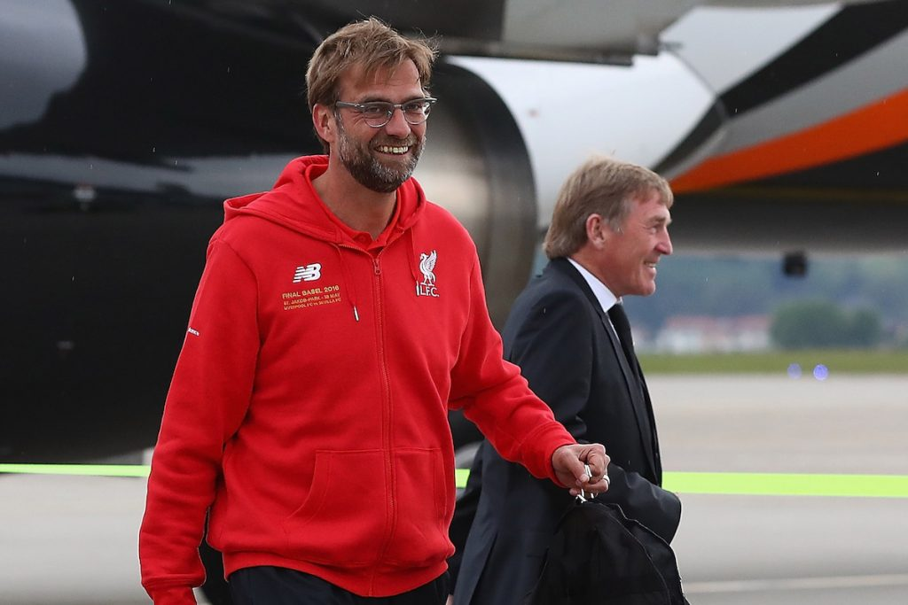 BASEL, SWITZERLAND - MAY 16: Liverpool's manager J¸rgen Klopp and non-executive director Kenny Dalglish arrive at Basel airport ahead of the UEFA Europa League Final against Sevilla. (Photo by UEFA/Pool)