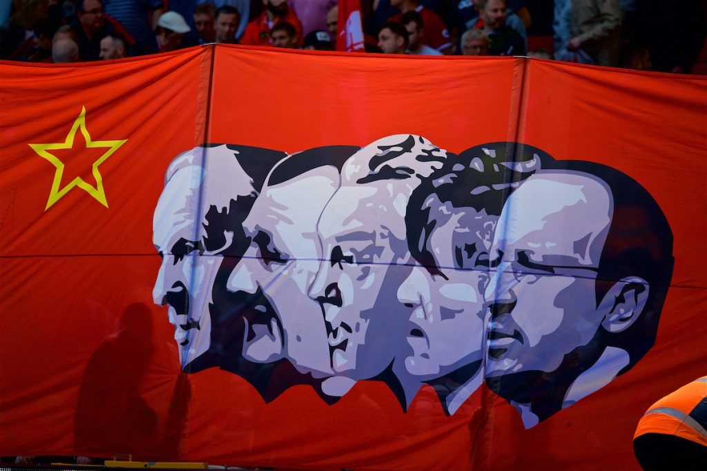 LIVERPOOL, ENGLAND - Sunday, May 13, 2018: A Liverpool supporters' banner on the Spion Kop featuring former managers Bill Shankly, Bob Paisley, Joe Fagan, Kenny Dalglish and Rafael Benitez in a Soviet style before the FA Premier League match between Liverpool FC and Brighton & Hove Albion FC at Anfield. (Pic by David Rawcliffe/Propaganda)