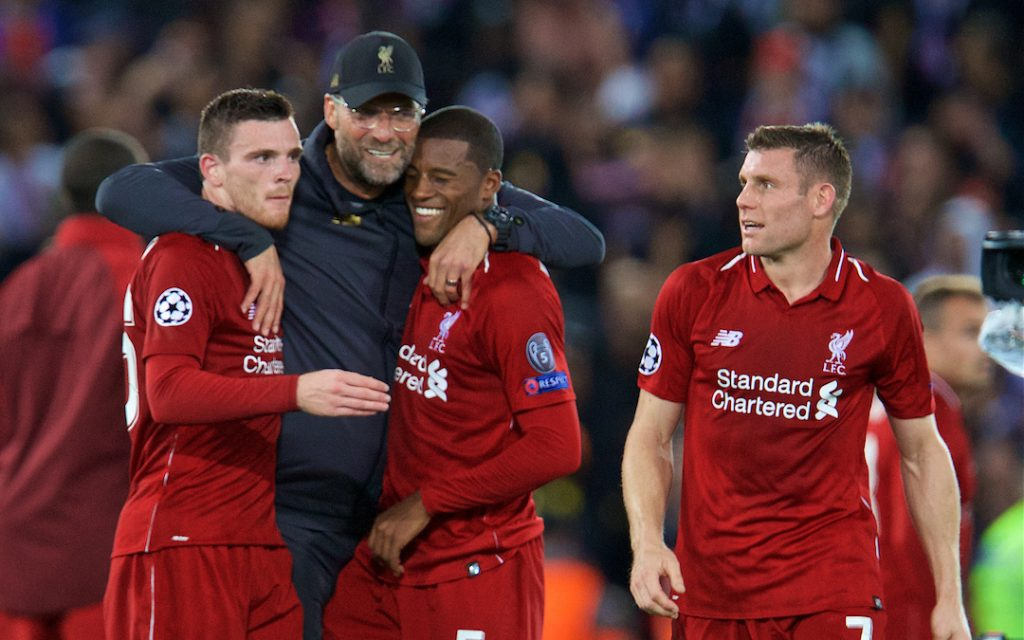 LIVERPOOL, ENGLAND - Tuesday, September 18, 2018: Liverpool's manager J¸rgen Klopp (2nd left) celebrates with Andy Robertson (left), Georginio Wijnaldum (2nd right) and James Milner (right) after the UEFA Champions League Group C match between Liverpool FC and Paris Saint-Germain at Anfield. Liverpool won 3-2. (Pic by David Rawcliffe/Propaganda)