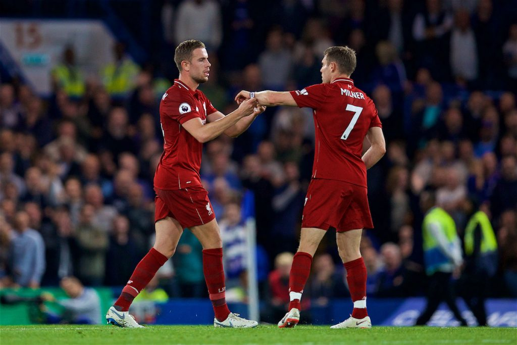 LONDON, ENGLAND - Saturday, September 29, 2018: Liverpool's captain Jordan Henderson (left) hands the captain's armband to James Milner during the FA Premier League match between Chelsea FC and Liverpool FC at Stamford Bridge. (Pic by David Rawcliffe/Propaganda)
