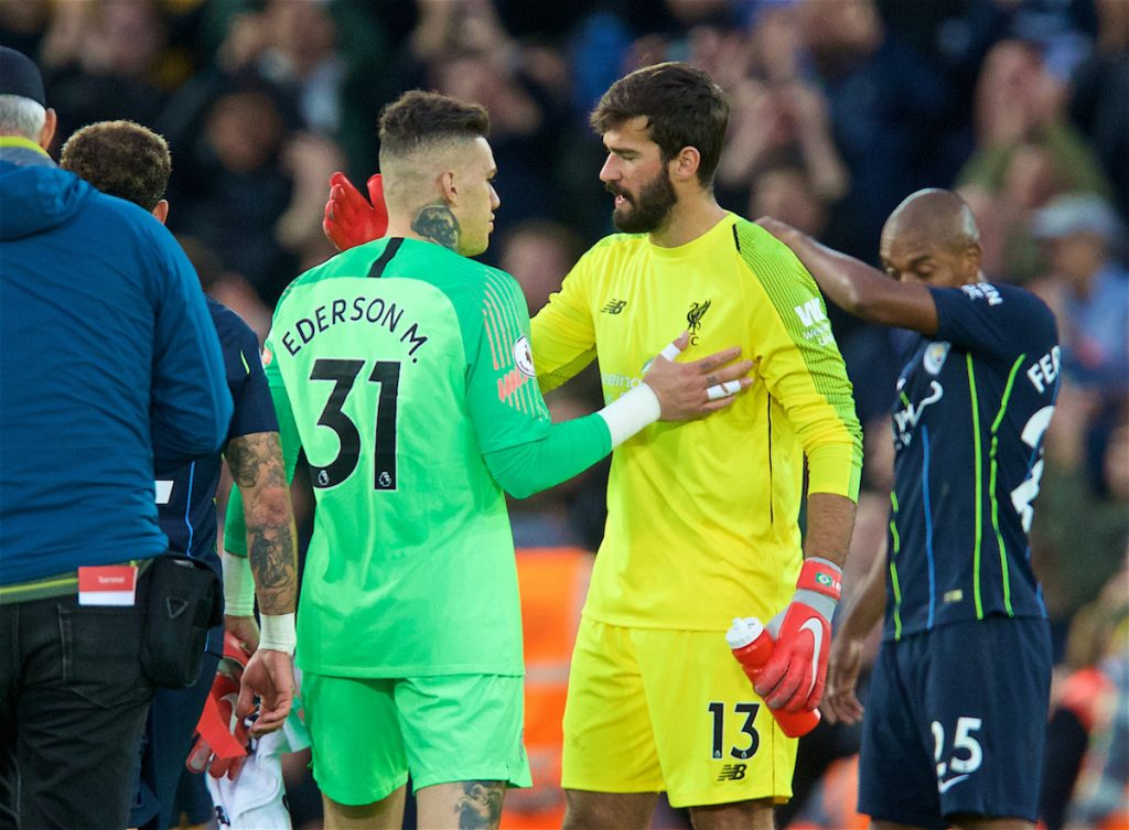 LIVERPOOL, ENGLAND - Sunday, October 7, 2018: Manchester City's goalkeeper Ederson Moraes (L) and Liverpool's goalkeeper Alisson Becker after the FA Premier League match between Liverpool FC and Manchester City FC at Anfield. The game ended goal-less. (Pic by David Rawcliffe/Propaganda)