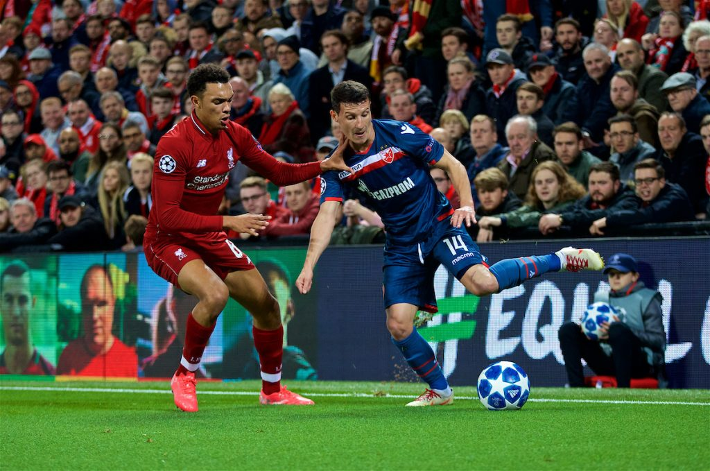 LIVERPOOL, ENGLAND - Wednesday, October 24, 2018: Liverpool's Trent Alexander-Arnold (L) and FK Crvena zvezda Slavoljub Srni? during the UEFA Champions League Group C match between Liverpool FC and FK Crvena zvezda (Red Star Belgrade) at Anfield. (Pic by David Rawcliffe/Propaganda)