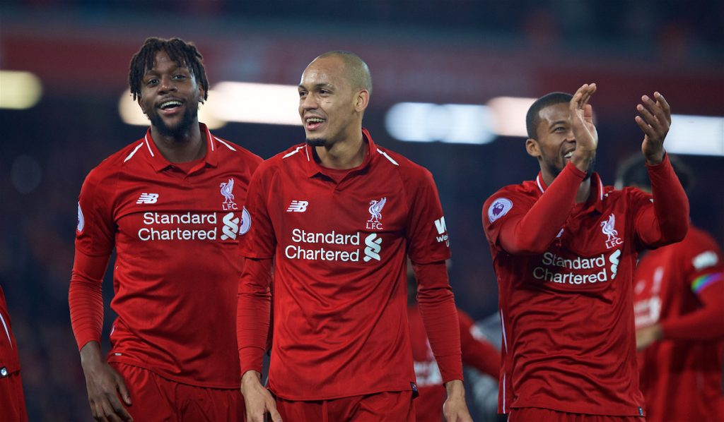 LIVERPOOL, ENGLAND - Sunday, December 2, 2018: Liverpool's match winning goal-scorer Divock Origi (L) celebrates with Fabio Henrique Tavares 'Fabinho' and Georginio Wijnaldum after a dramatic late injury time goal during the FA Premier League match between Liverpool FC and Everton FC at Anfield, the 232nd Merseyside Derby. Liverpool won 1-0. (Pic by Paul Greenwood/Propaganda)