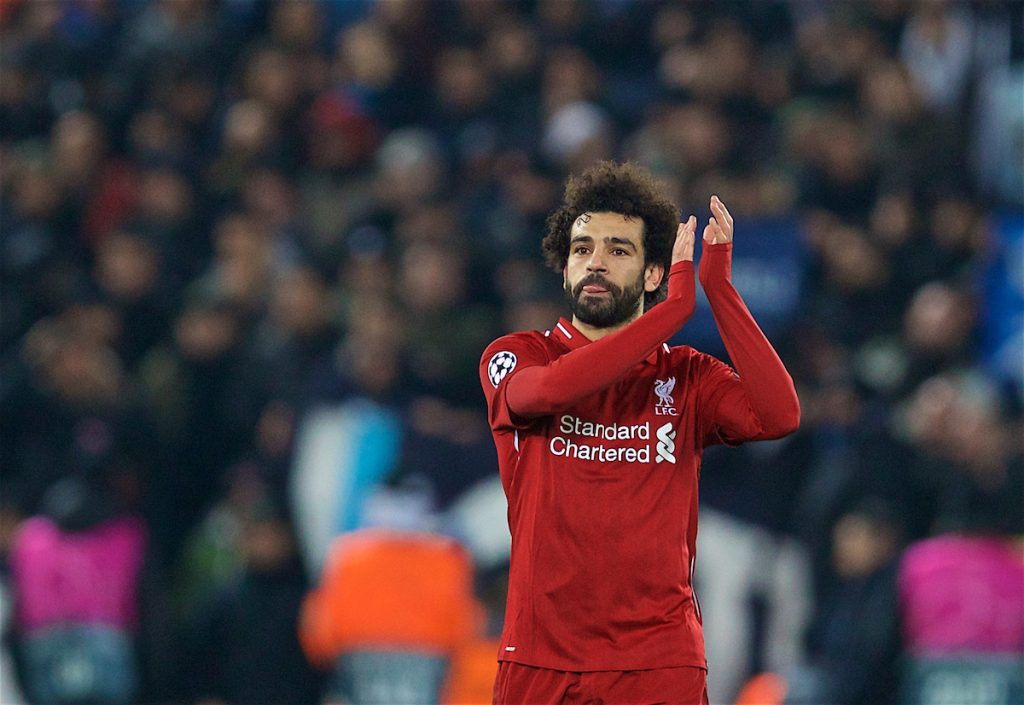 LIVERPOOL, ENGLAND - Tuesday, December 11, 2018: Liverpool's goal-scorer Mohamed Salah celebrates after beating SSC Napoli 1-0 and progressing to the knock-out phase during the UEFA Champions League Group C match between Liverpool FC and SSC Napoli at Anfield. (Pic by David Rawcliffe/Propaganda)