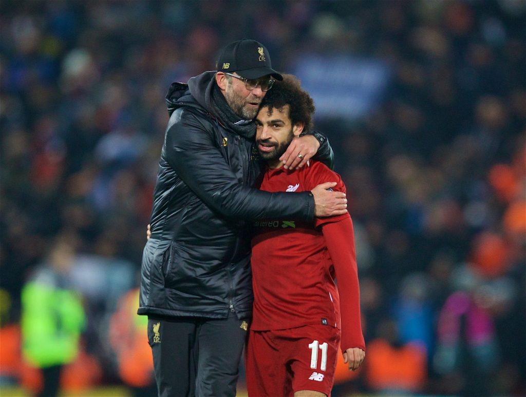 LIVERPOOL, ENGLAND - Tuesday, December 11, 2018: Liverpool's manager Jürgen Klopp celebrates with goal-scorer Mohamed Salah after beating SSC Napoli 1-0 and progressing to the knock-out phase during the UEFA Champions League Group C match between Liverpool FC and SSC Napoli at Anfield. (Pic by David Rawcliffe/Propaganda)